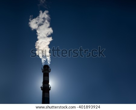 Industrial pipe on a background of blue sky