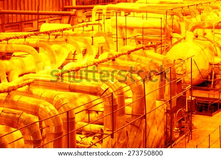 Industrial pipeline.Interior of chemical factory - stock photo