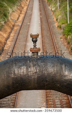 Industrial pipeline over railroad   - stock photo
