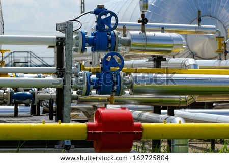 industrial pipes at an oil well - stock photo