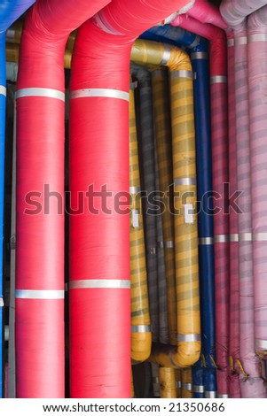 Industrial pipes covered with colorful insulation