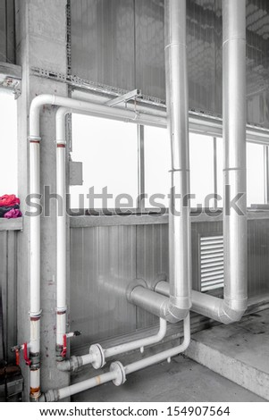 Industrial pipes of a building closeup - stock photo