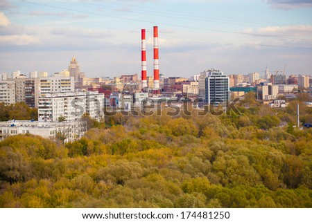 Industrial pipes red and white in a residential part of the city. park in the city - stock photo