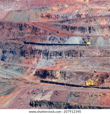 industrial pit iron ore mining, ore delivery by rail and road - stock photo