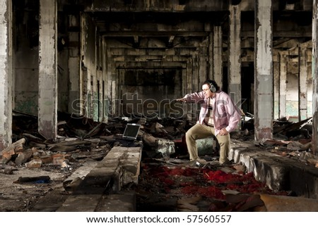 industrial place and man in pink shirt - stock photo