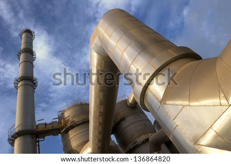 Industrial plant against blue sky - stock photo