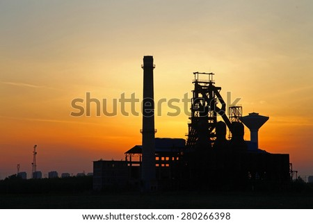 Industrial plant equipment in the sunset