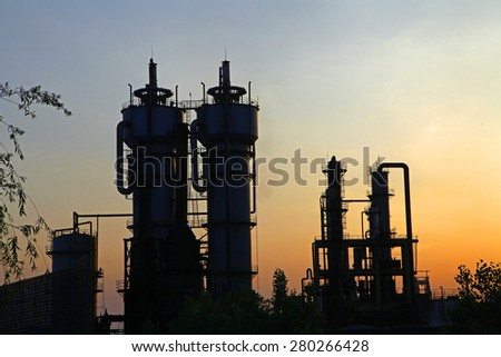 Industrial plant equipment in the sunset - stock photo