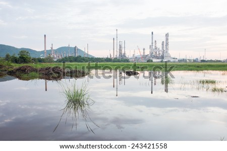Industrial plant power station and the sun light - stock photo
