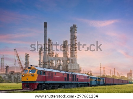 Industrial plant power station and train on the sun light - stock photo
