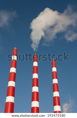 Industrial plant smoke stacks.