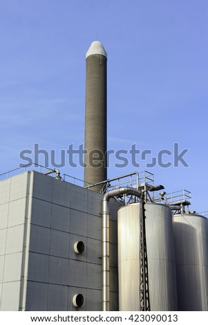 Industrial Plant with Chimneys and Pipes