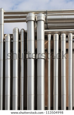 Industrial Plant with many steel pipelines - stock photo