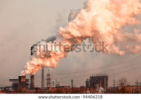 Industrial plant with smoke. Air pollution concept - stock photo