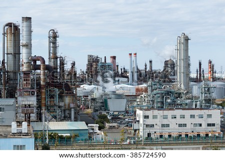 Industrial plant with smoke from the chimney - stock photo