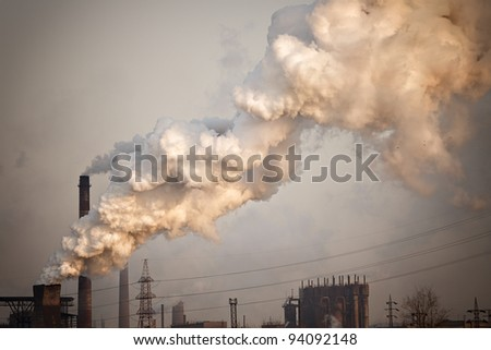 Industrial plant with yellow smoke. Air pollution concept