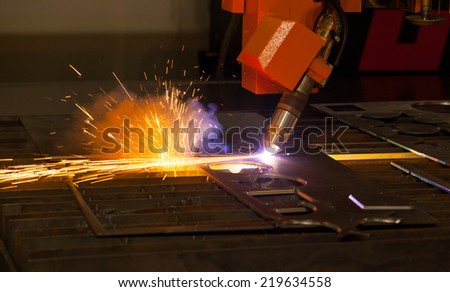 Industrial plasma cutting machine with sparks - stock photo