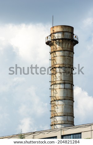 Industrial Power Plant Factory Tower With Polluted Sky - stock photo