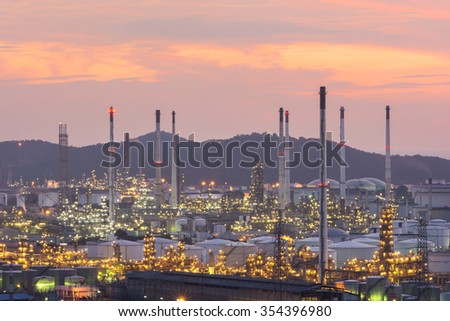 industrial power plant oil station night landscape with lights at sunset