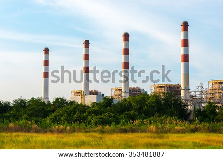 Industrial power plant with blue sky.
