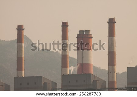 Industrial power plant with smokestack, the power plant production on hot condition in the mountain. - stock photo