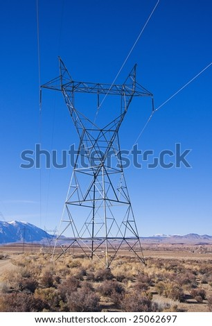 Industrial Power Transmission Lines in the Desert with Blue Sky