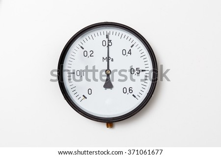 Industrial pressure gauge on a white background