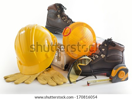 Industrial Protective Workwear. Includes Hard Hat, Gloves, Shoes, Ear Muff and Eyewear. - stock photo