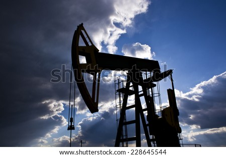 Industrial pump jack - stock photo