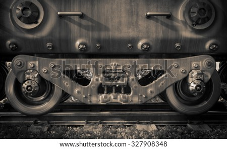 Industrial rail train wheels closeup technology black and white photo - stock photo