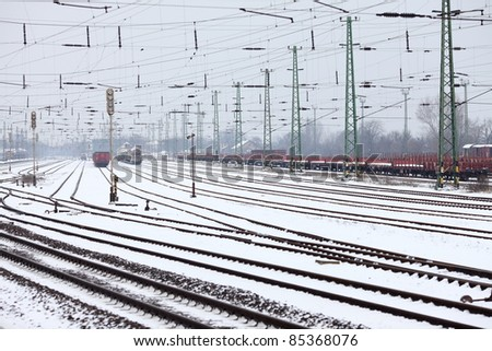 Industrial railroad station in snow - stock photo