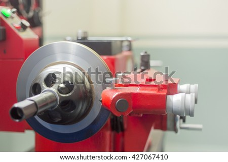 Industrial Red lathe tool and part of the lathe,lathe machine - stock photo