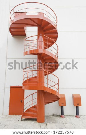 Industrial red staircase in foreign companies - stock photo