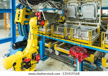 industrial robot on production line for foam - stock photo