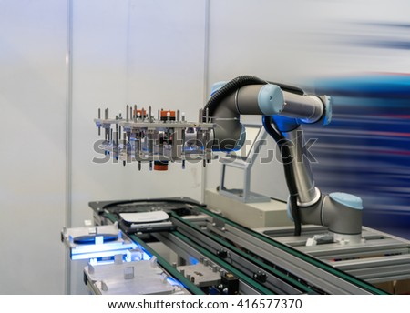 Industrial robot working in factory,Conveyor Tracking Controler of robotic hand. - stock photo