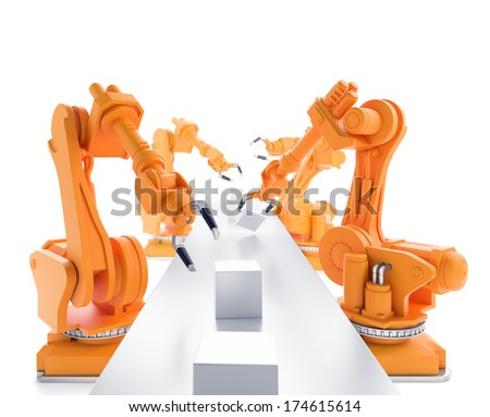 Industrial robots working on a production line - stock photo