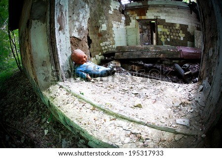 Industrial Ruins with old baby doll, toned photo, fisheye effect