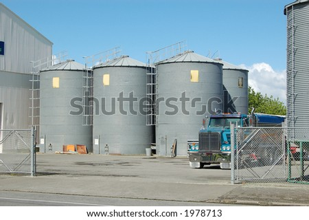 Industrial scene-seed silos and truck in driveway