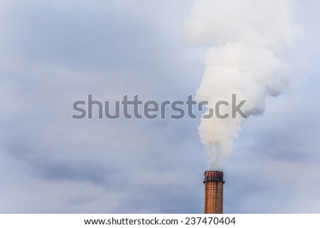 Industrial scenery with coal powered plant stacks and smoke