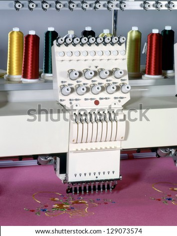 Industrial sewing machine - stock photo