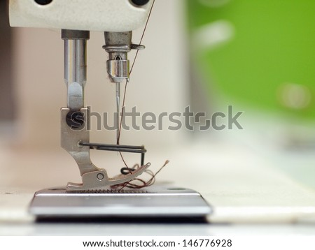 industrial sewing machine close up details - stock photo
