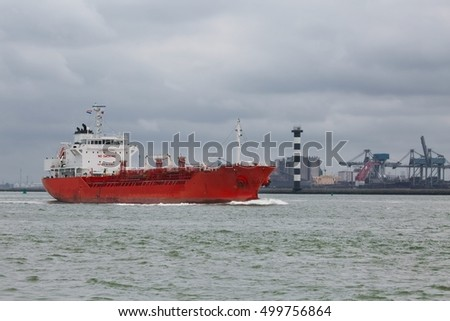 Industrial ship headig out of the port