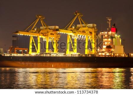 Industrial shipping port at night in Bangkok, Thailand - stock photo