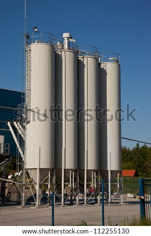 Industrial silos for loose material storing - stock photo