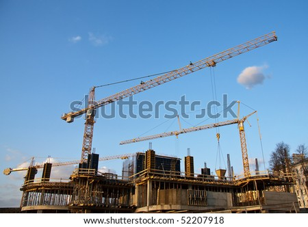 Industrial site with construction cranes - stock photo
