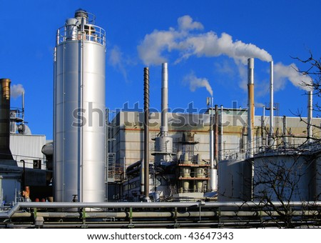 Industrial site with smoking stacks