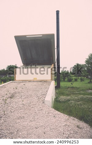 industrial site with steel storage units for heating - vintage retro look