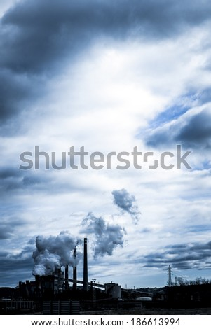 industrial smoke from chimney, Asturias, Spain - stock photo