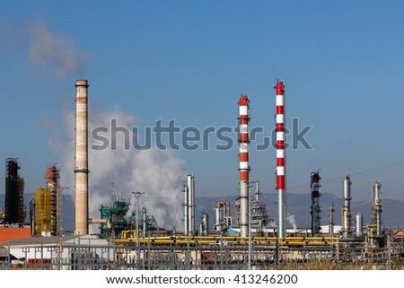 Industrial smoke from chimney in a refinery - stock photo