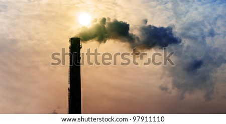 industrial smoke from chimney on sky - stock photo